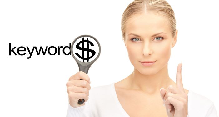 22521319_l- business and seo concept - woman with magnifying glass and keywords word